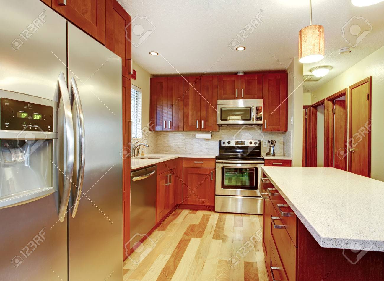 Small Kitchen With Hardwood Floor Cherry Cabinets And Steel Stock Photo Picture And Royalty Free Image Image 26496076