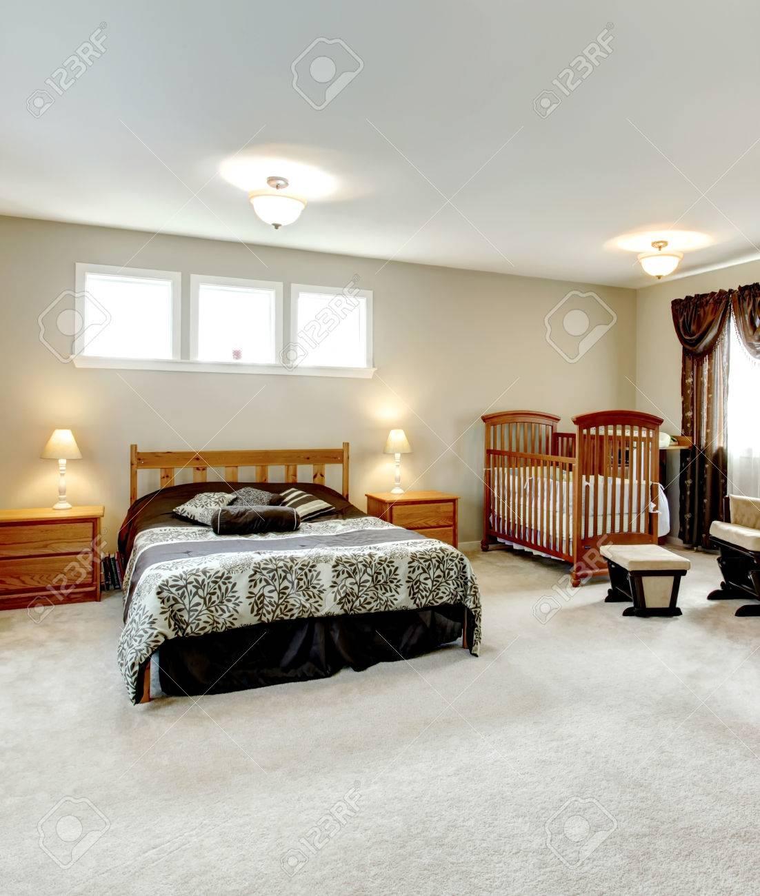 Big Master Bedroom With A Walk In Closet. Nursery Corner With A Crib.