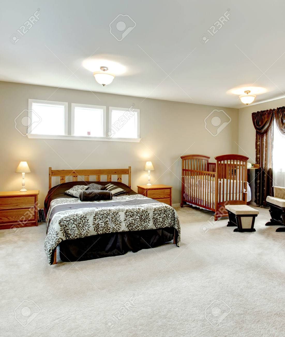 Big Master Bedroom With A Walk In Closet. Nursery Corner With A Crib.