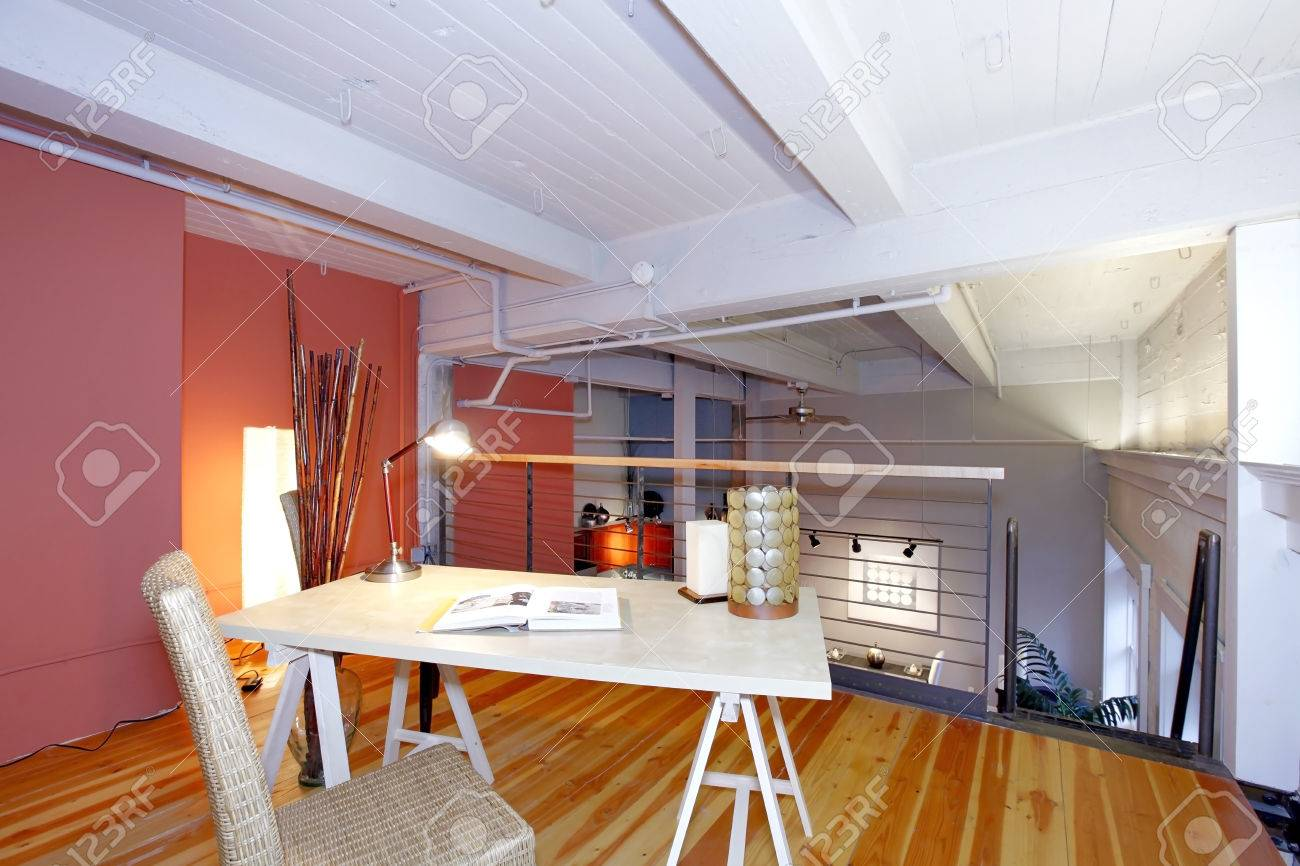 Mezzanine office in reconstructred modern living room. Furnished with simple desk and chair. Stock Photo - 26525229