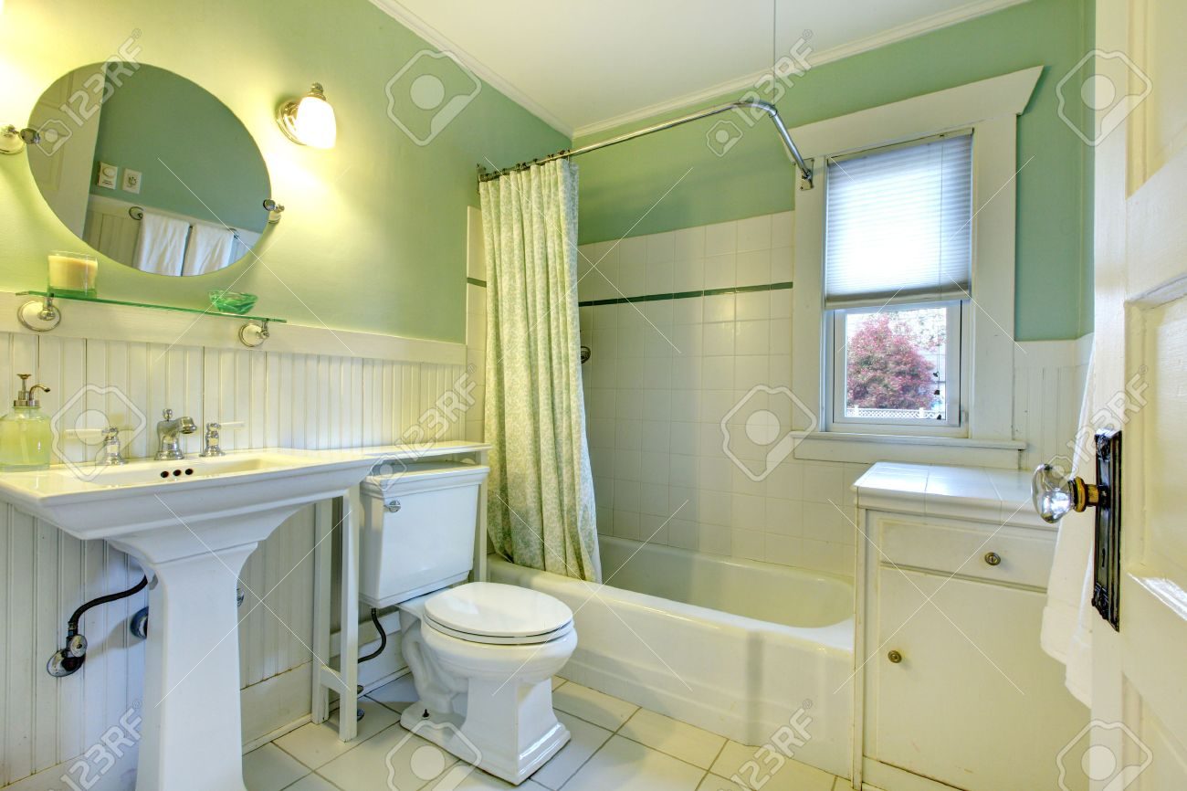 Mint Bathroom With Light Green Curtains, Tile Floor And Wood.. Stock ...