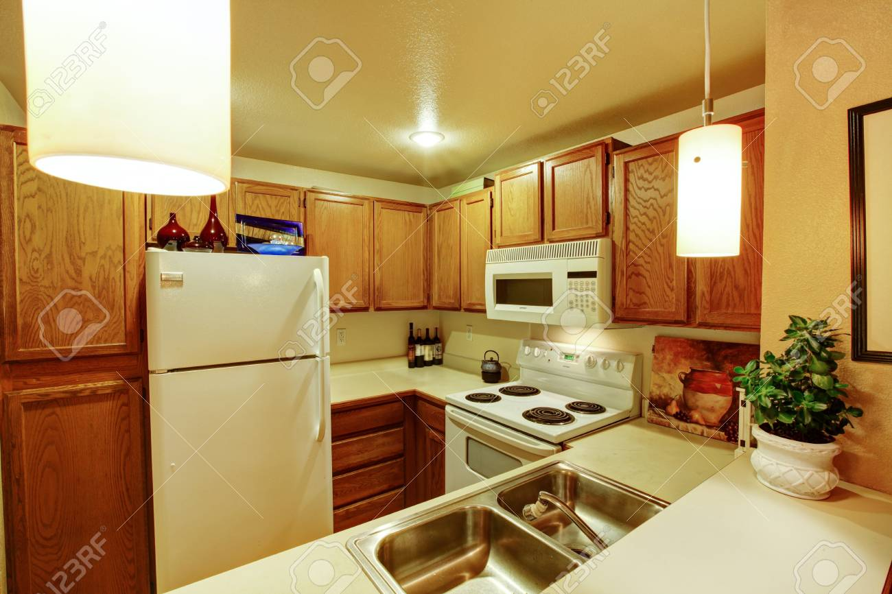 View Of Kitchen Cabinets With Sink And White Old Appliances Stock ...