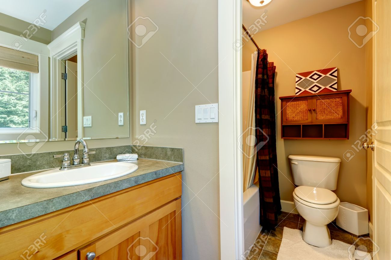 Stock Photo   View Of Washbasin Cabinet And Small Bathroom In Master Bedroom