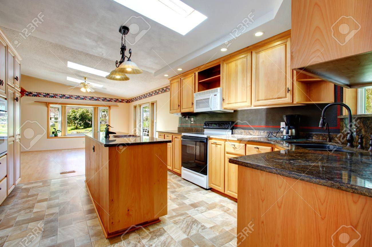 View Of Kitchen With Tile Floor And Vaulted Ceiling Furnished