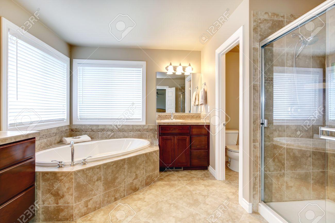 Beige Bathroom With Windows Cherry Wooden Cabinets Glass Door – White and Beige Bathroom