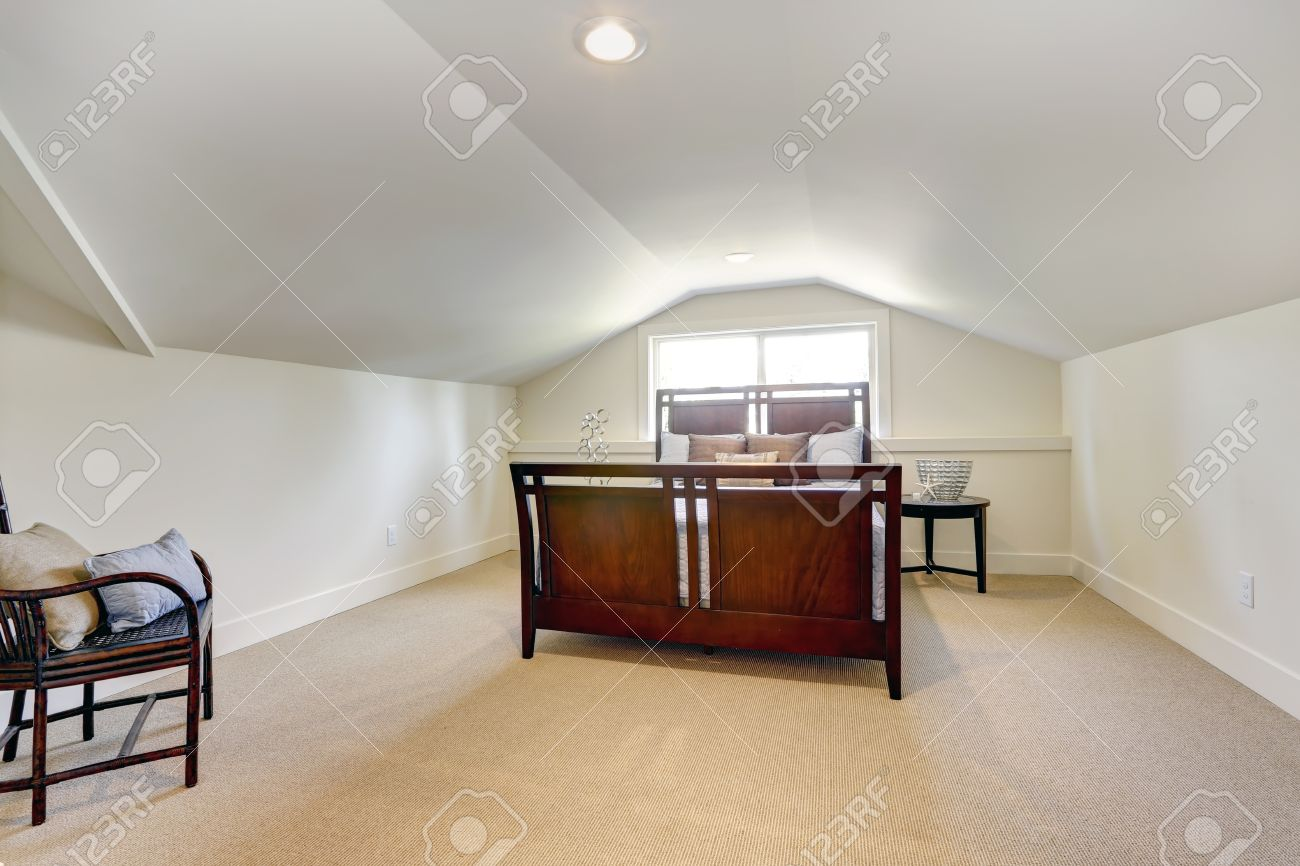 Bedroom with low vaulted ceiling. View of beautiful bedroom furniture..