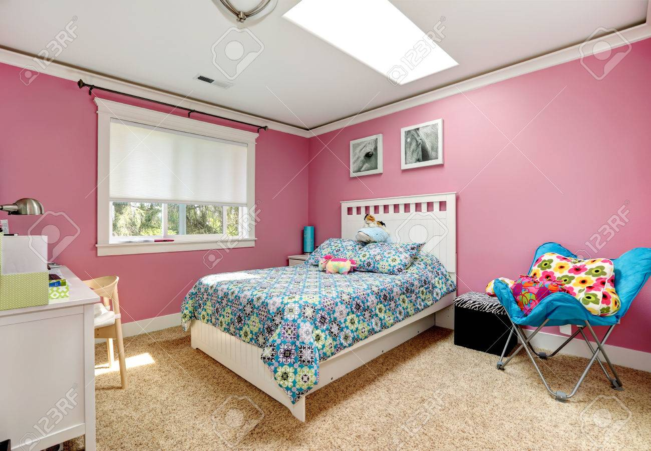 Gentle girls bedroom with white bed and pink walls View of bed..