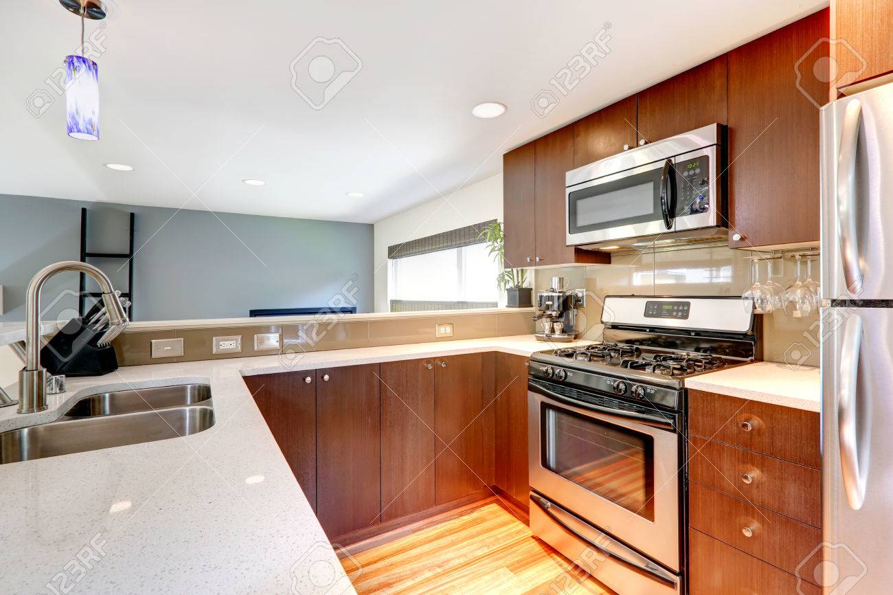 Small kitchen area in a modern apartment View of cabinets, steel..