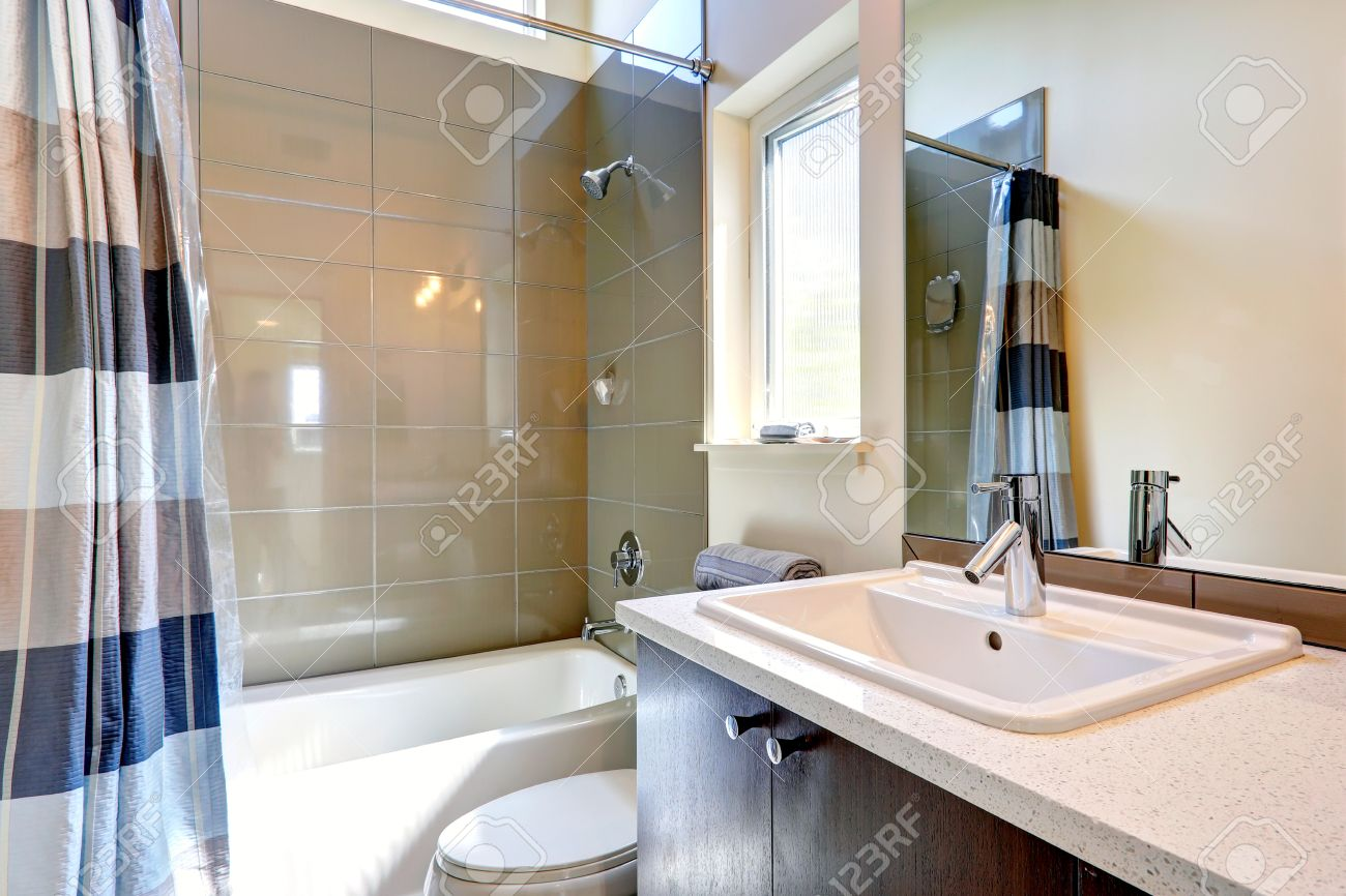 trim in small bathrooms. Small bathroom with window  View of washbasin cabinet mirror and tub tile wall Bathroom With Window Of Washbasin Cabinet Mirror