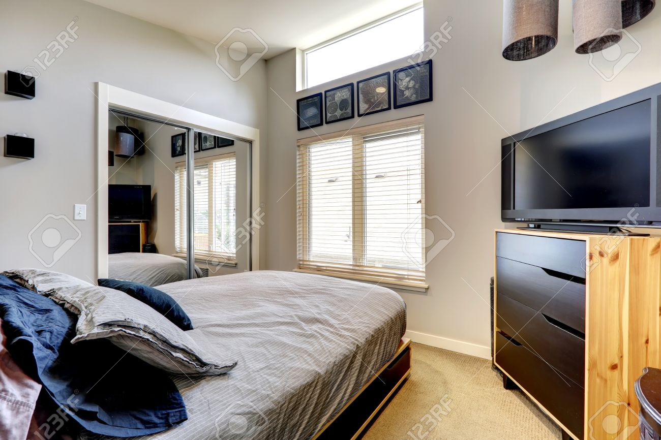 Small Bedroom Tv Small Bedroom With Mirror Door Closet Single Bed And Tv Stock