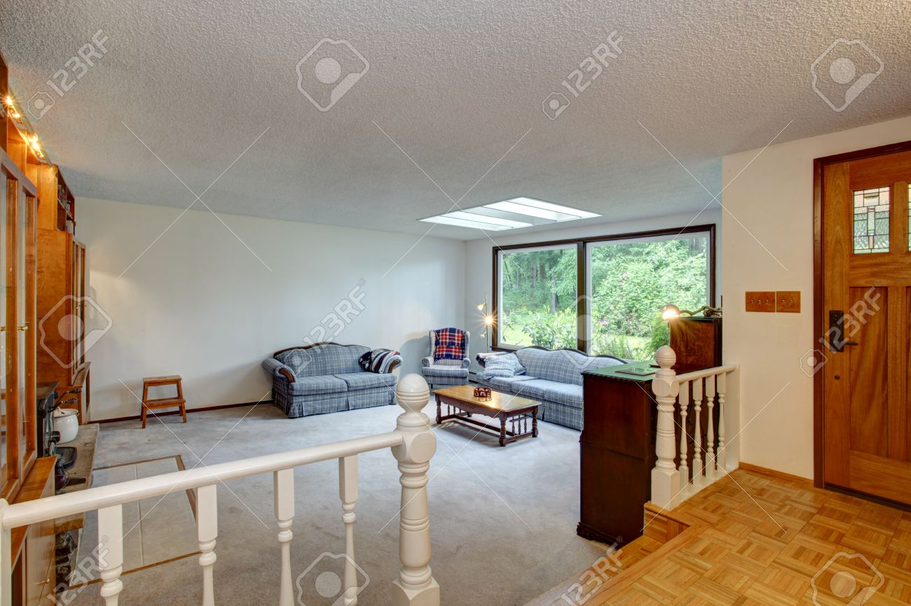 Farm House Interior View Of Living Room From Entrance Hallway With Railings And Stairs Stock Photo