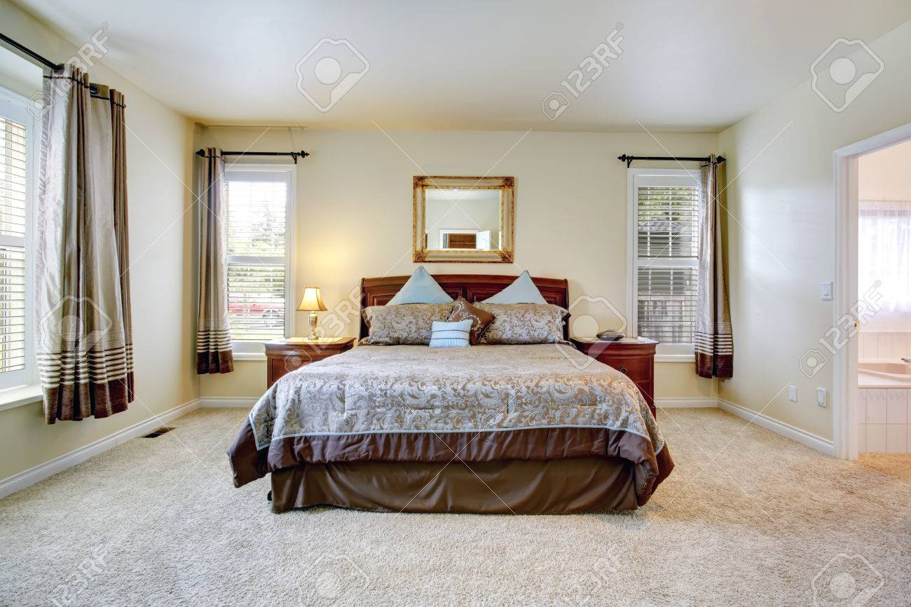 Elegant Master Bedroom With Rich Furniture Set And Beautiful Stock