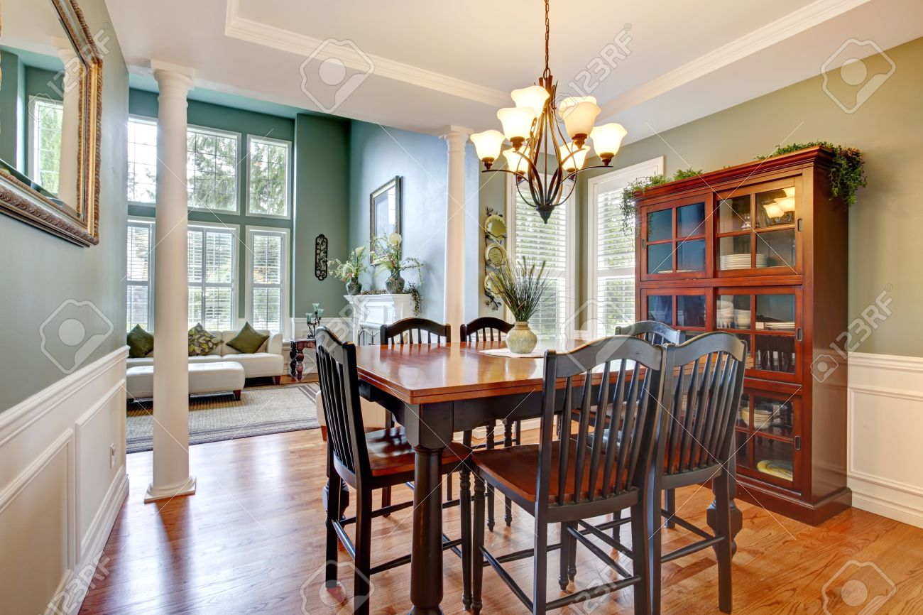 Luxury House With High Ceiling And Columns Dining Room With - Dining room storage cabinets