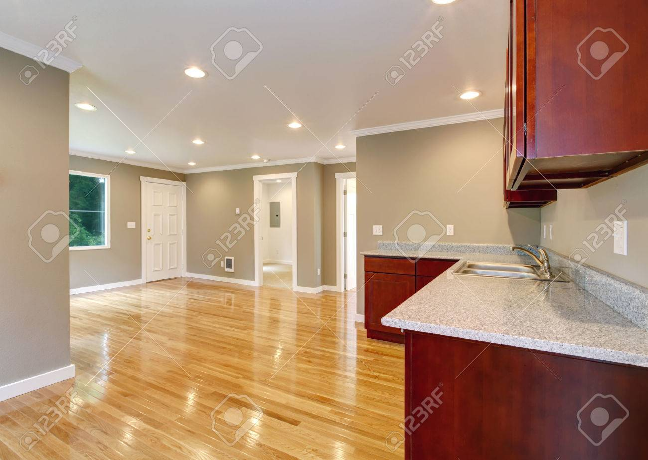 Kitchen Cabinets View Of Empty Living Room And Entrance Door Stock Photo