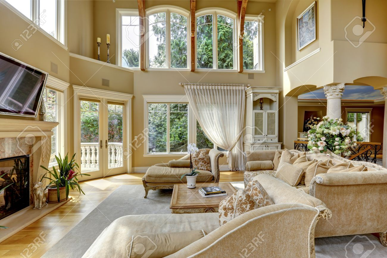 Impressive High Ceiling Living Room With Tv, Fireplace And Antique ...