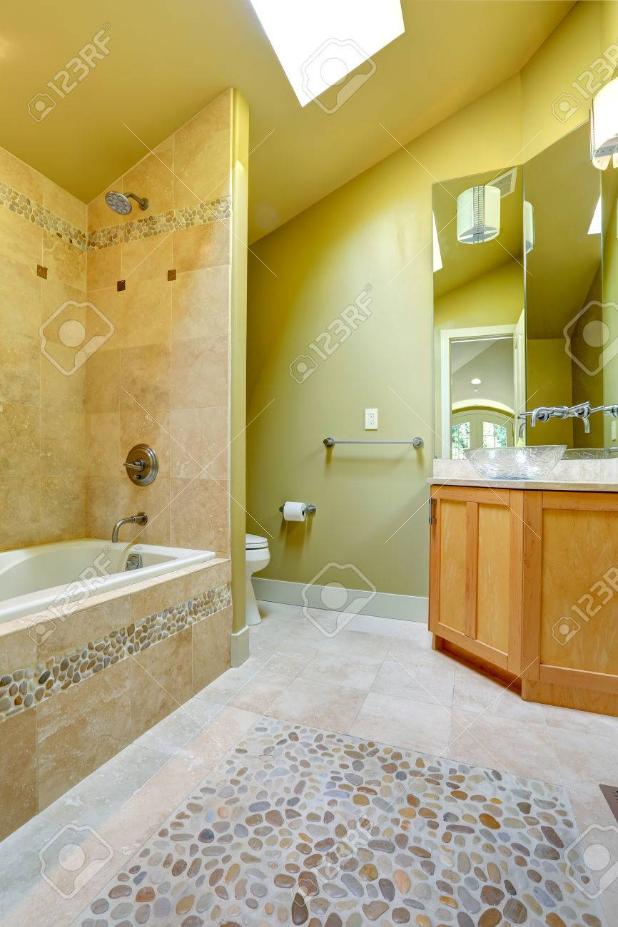 Vaulted Ceiling Bathroom With Green Wall. View Of Bath Tub With ...