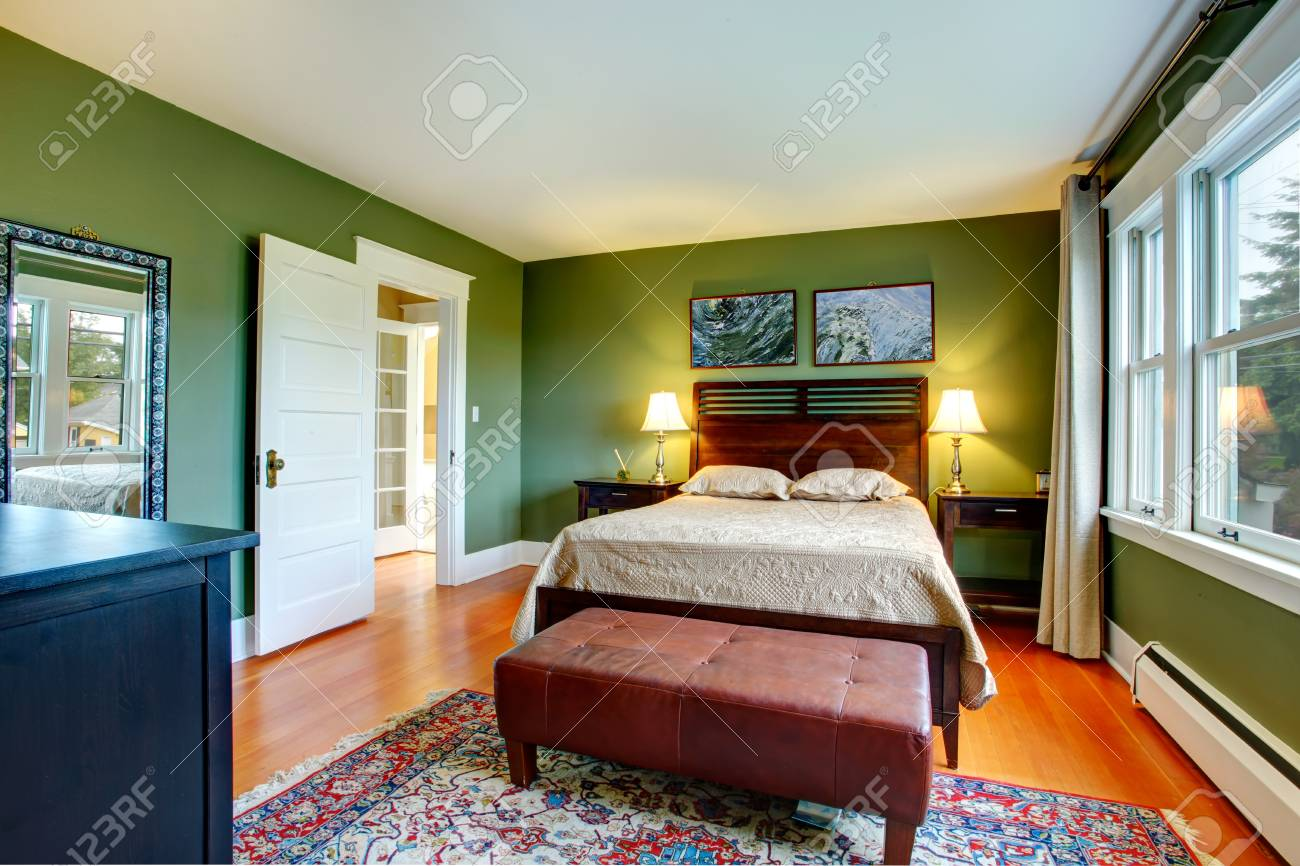 Green Walls Bedroom With High Headboard Bed Leather Ottaman Stock Photo Picture And Royalty Free Image Image 27593755