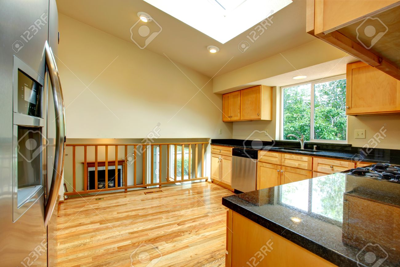 Spacious Empty Kitchen Room Upstairs Overlooking Living Room Kitchen Has  Storage Combination And Steel Appliances Stock