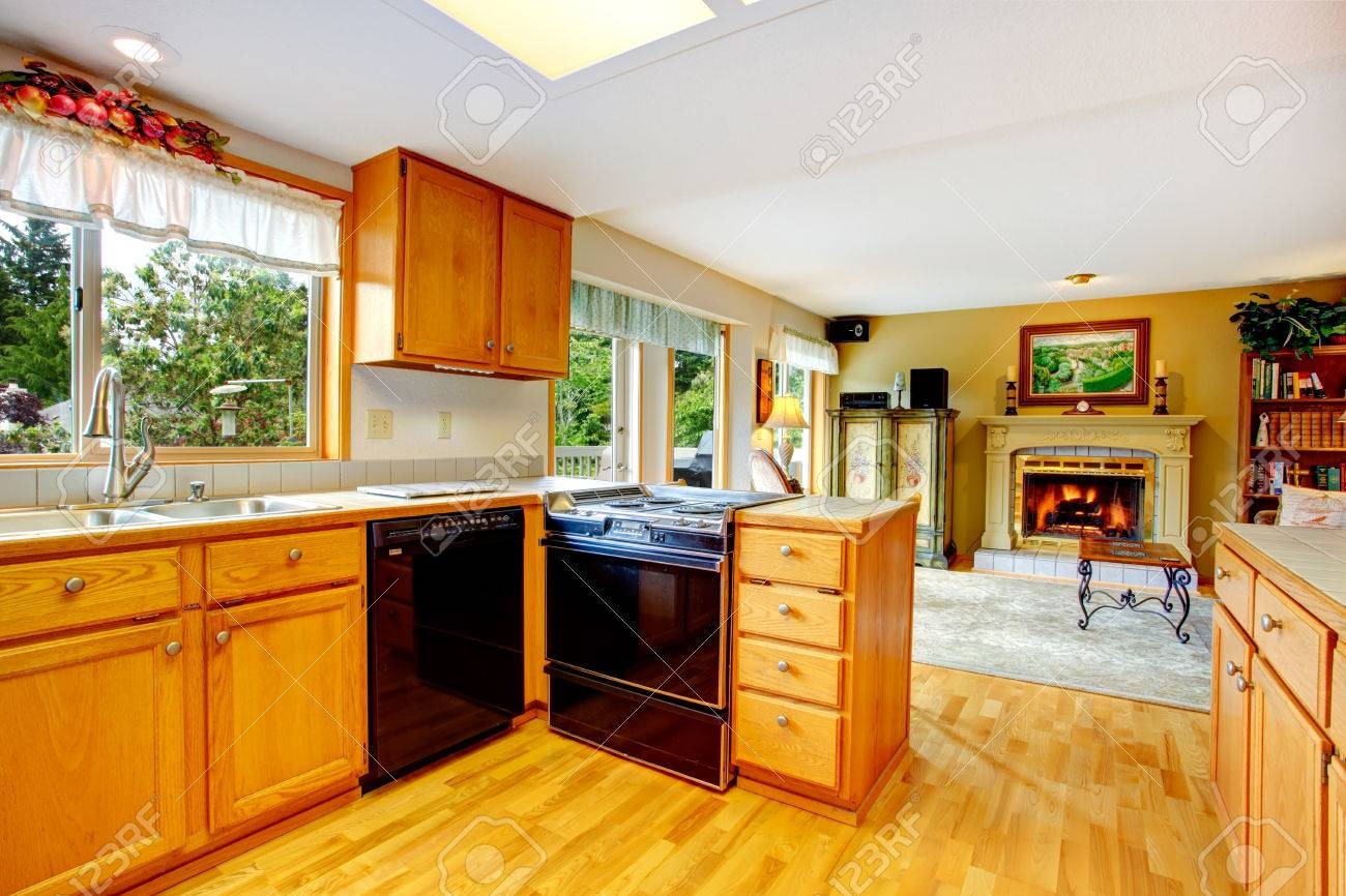 Wooden Cabinets For Living Room Kitchen Room With Wooden Cabinets And Black Appliances View