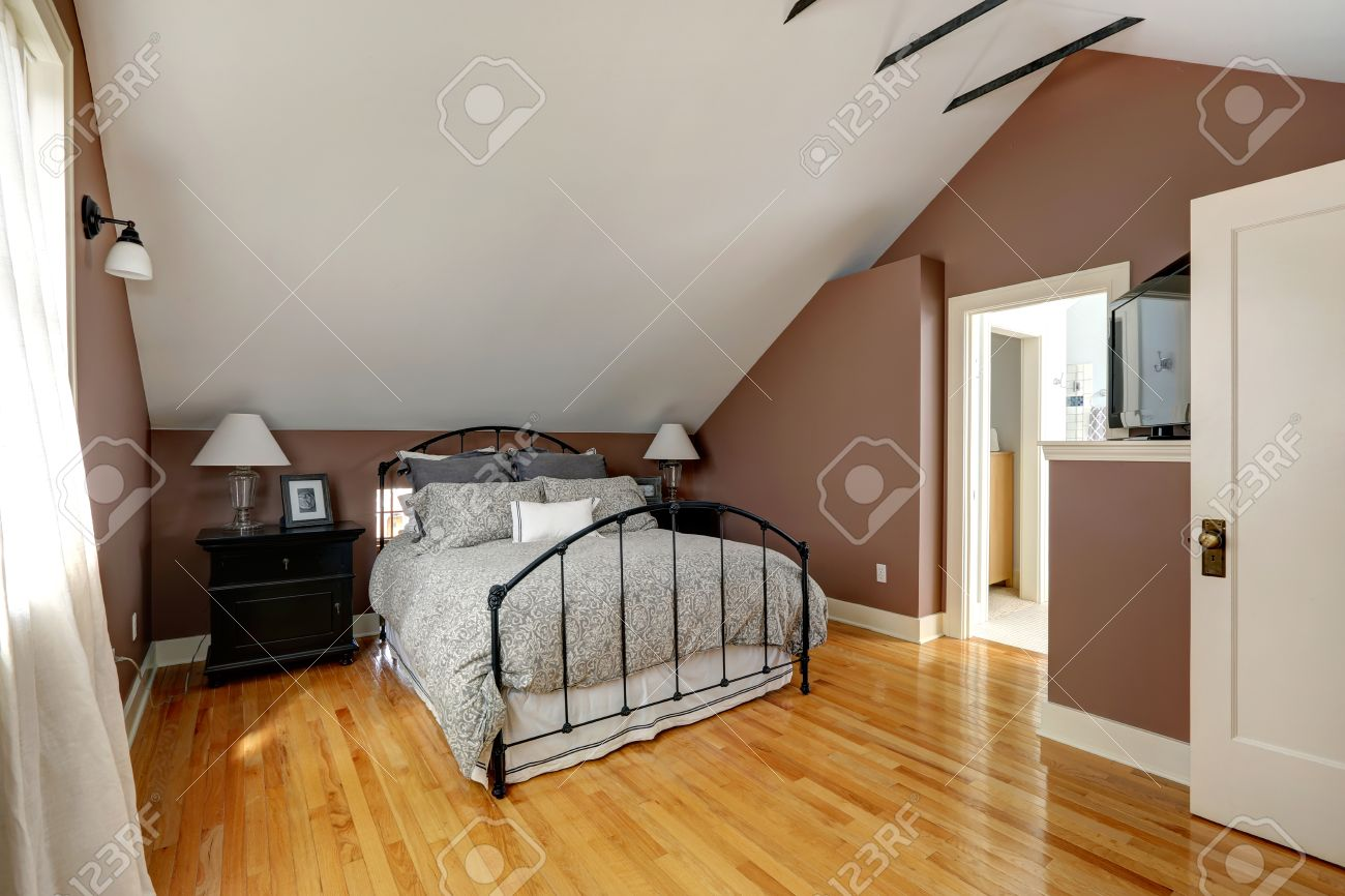 Stock Photo   White and mocha velux bedroom with iron frame bed and black  nightstands. White And Mocha Velux Bedroom With Iron Frame Bed And Black