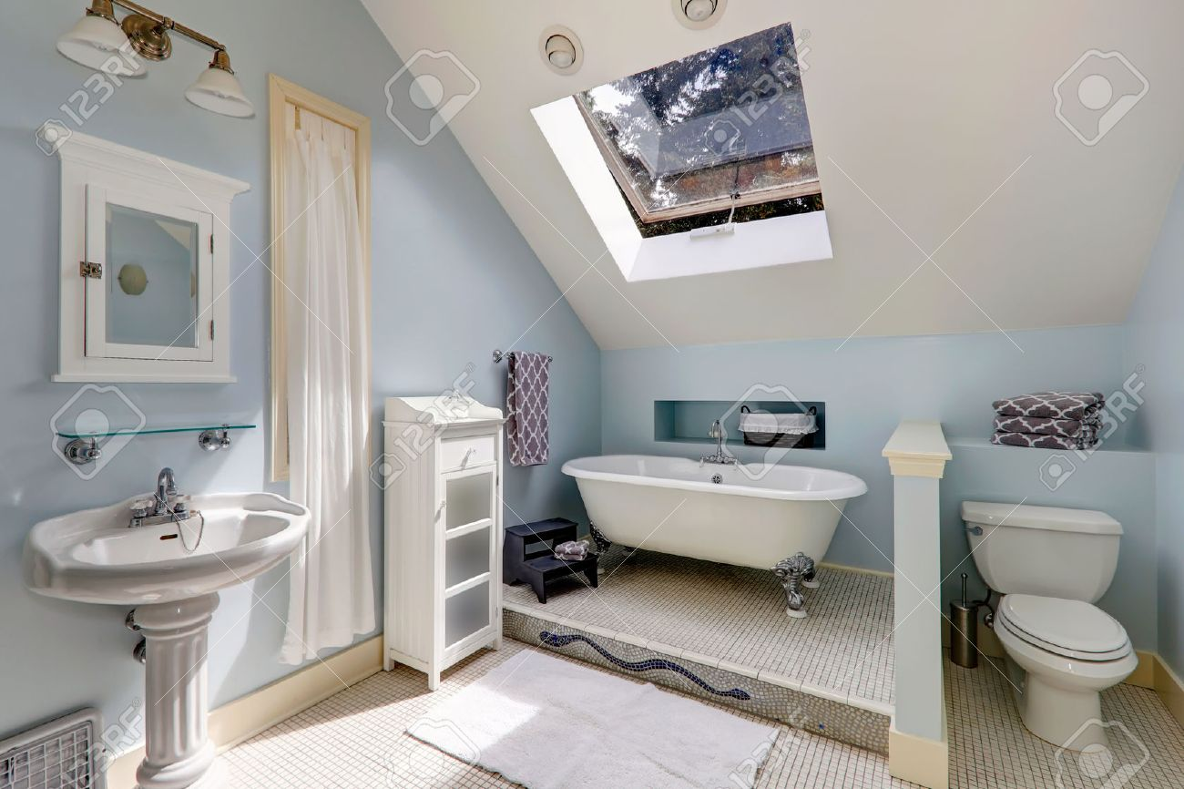Light blue and white bathroom - Light Blue Velux Bathroom With Window View Of White Antique Freestanding Bath Tub Washbasin Stand