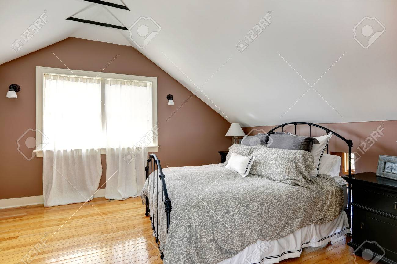 velux mocha and white bedroom with curtained window and iron stock