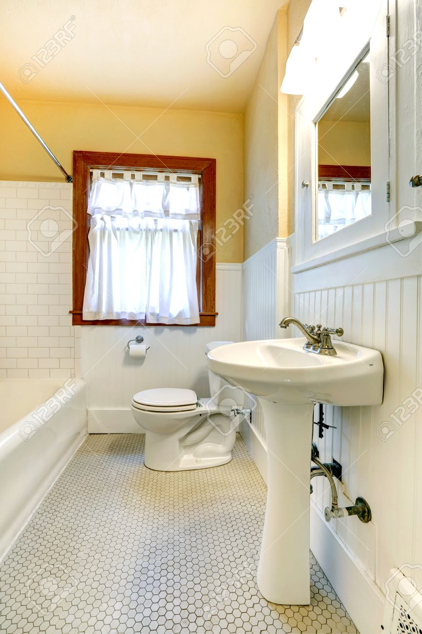 Bathroom With Wood Plank Paneled Wall And Tile Trim Wall Stock Photo ...