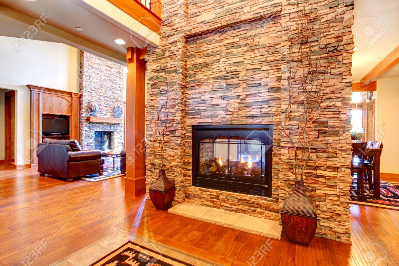 beautiful stone wall with built in fake fireplace two vases