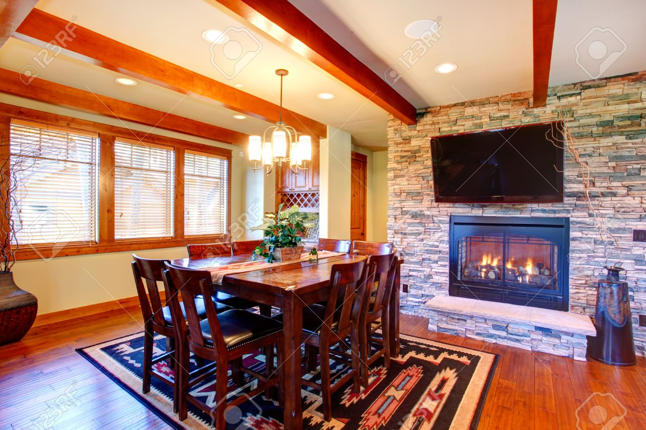 Dining room interior Ceiling beams blend perfectly with stone wall trim and  fireplace Dining room has. Dining Room Interior Ceiling Beams Blend Perfectly With Stone