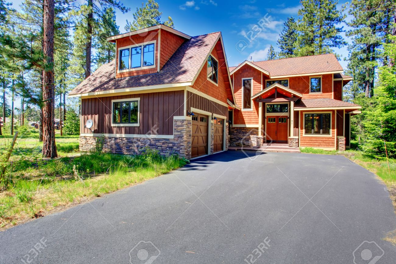 big luxury house with brown and orange siding trim view of big luxury house with brown and orange siding trim view of entrance porch and two