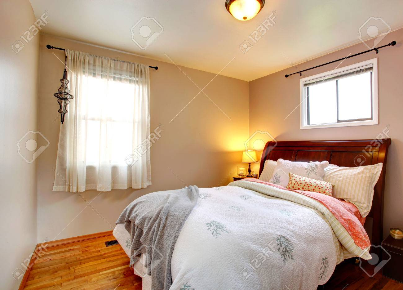 Small bedroom with queen size bed and refreshing bedding