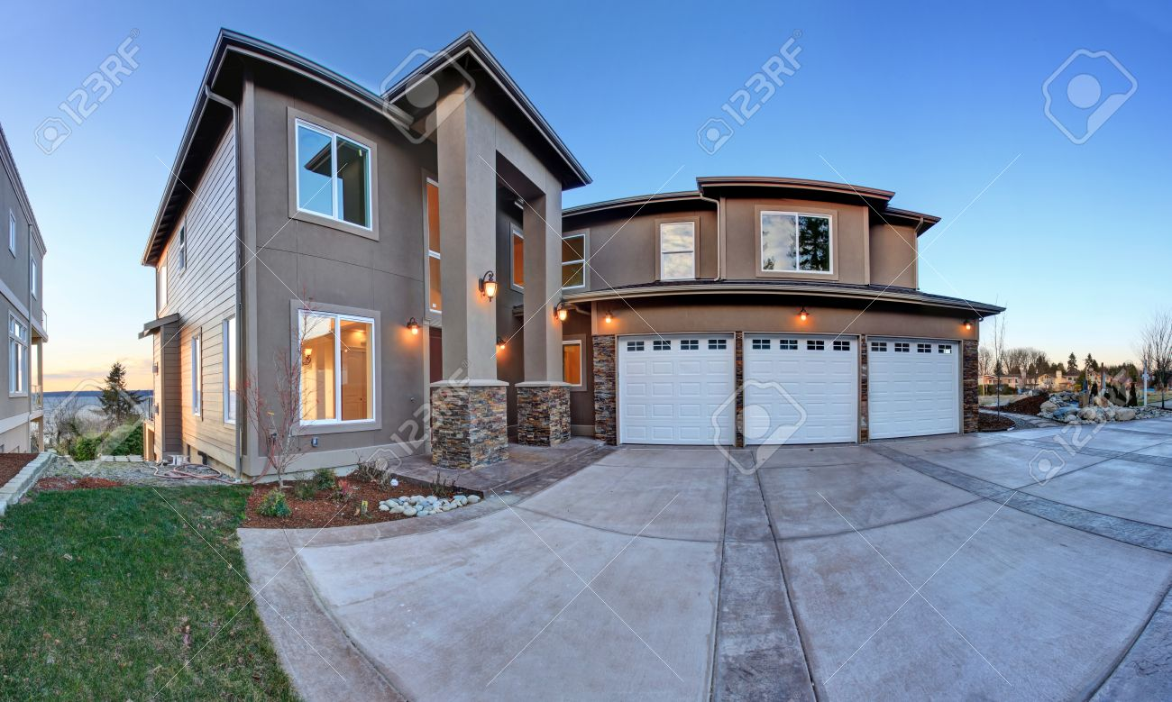 Luxury House Exterior luxury house exterior with three car garage and driveway evening
