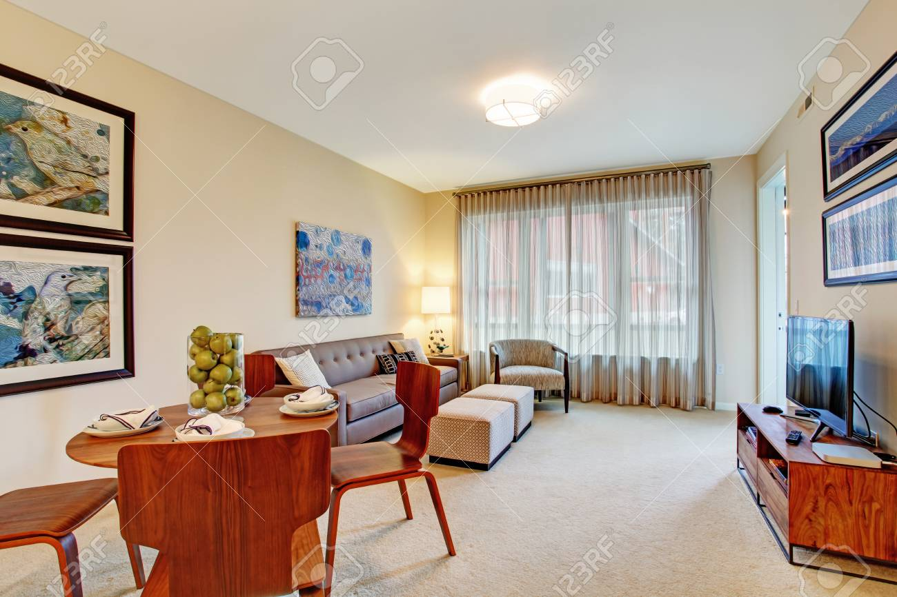 Open floor plan  Living room with dining area  View of served table Stock Photo - 28082809