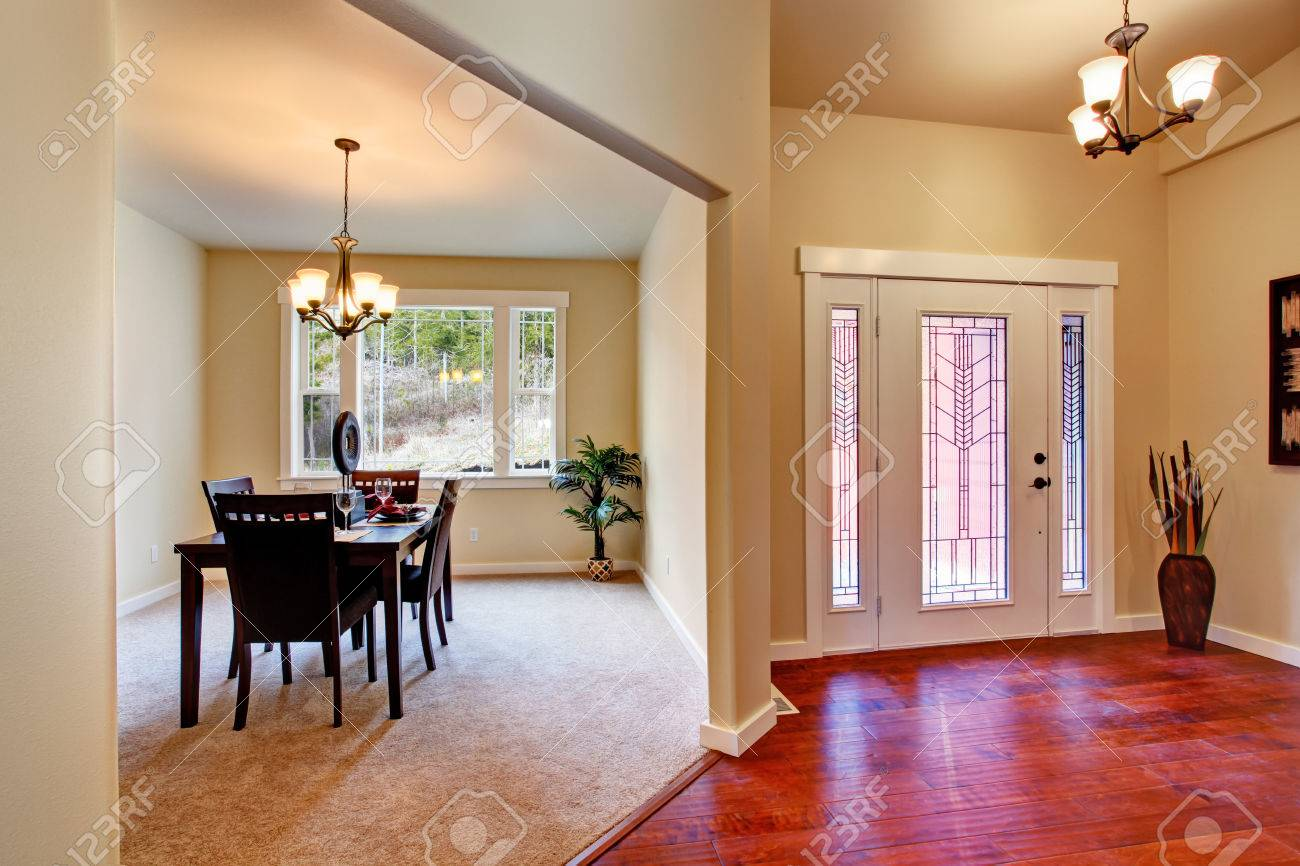 House Interior View Of Entrance Hallway And Dining Area With Served Table Stock Photo