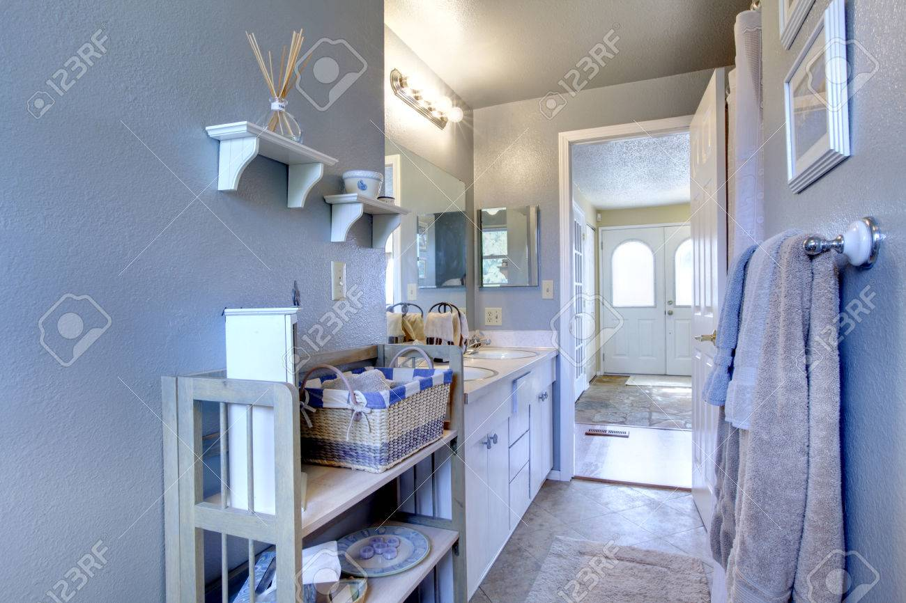 Bathroom With Wooden Shelf View Of Entance Hallway Through The ...