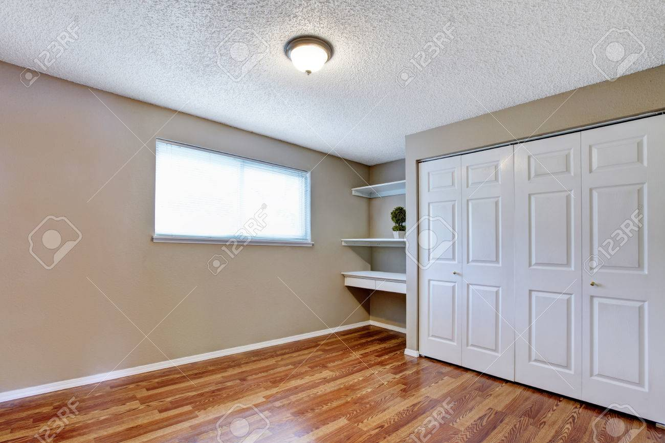 Empty Room With Hardwood Floor Closet Small Window And Wall