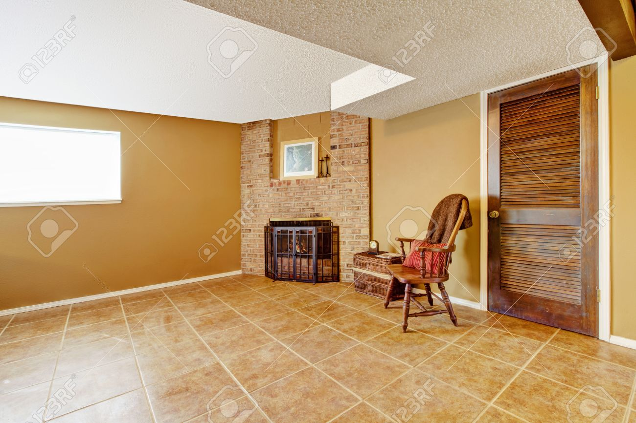 Empty Living Room With Tile Floor View Of Corner With Fierplace