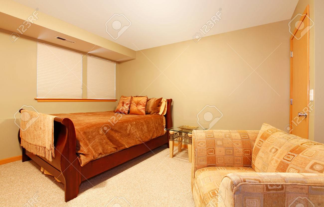 Garden level simple guest bedroom with one single bed and large..