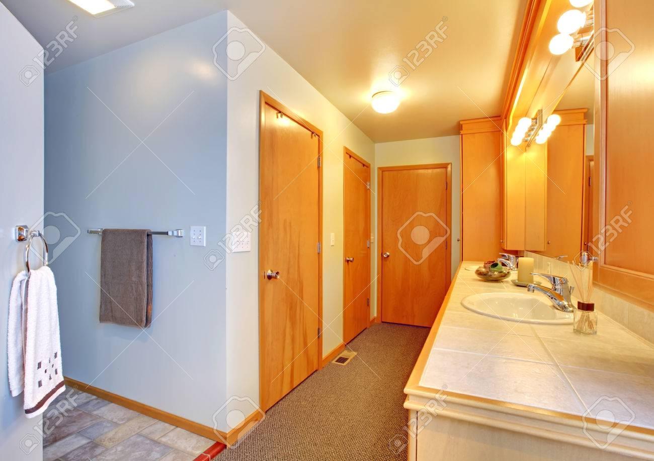 Bathroom with many doors to closets interior Stock Photo - 28393620