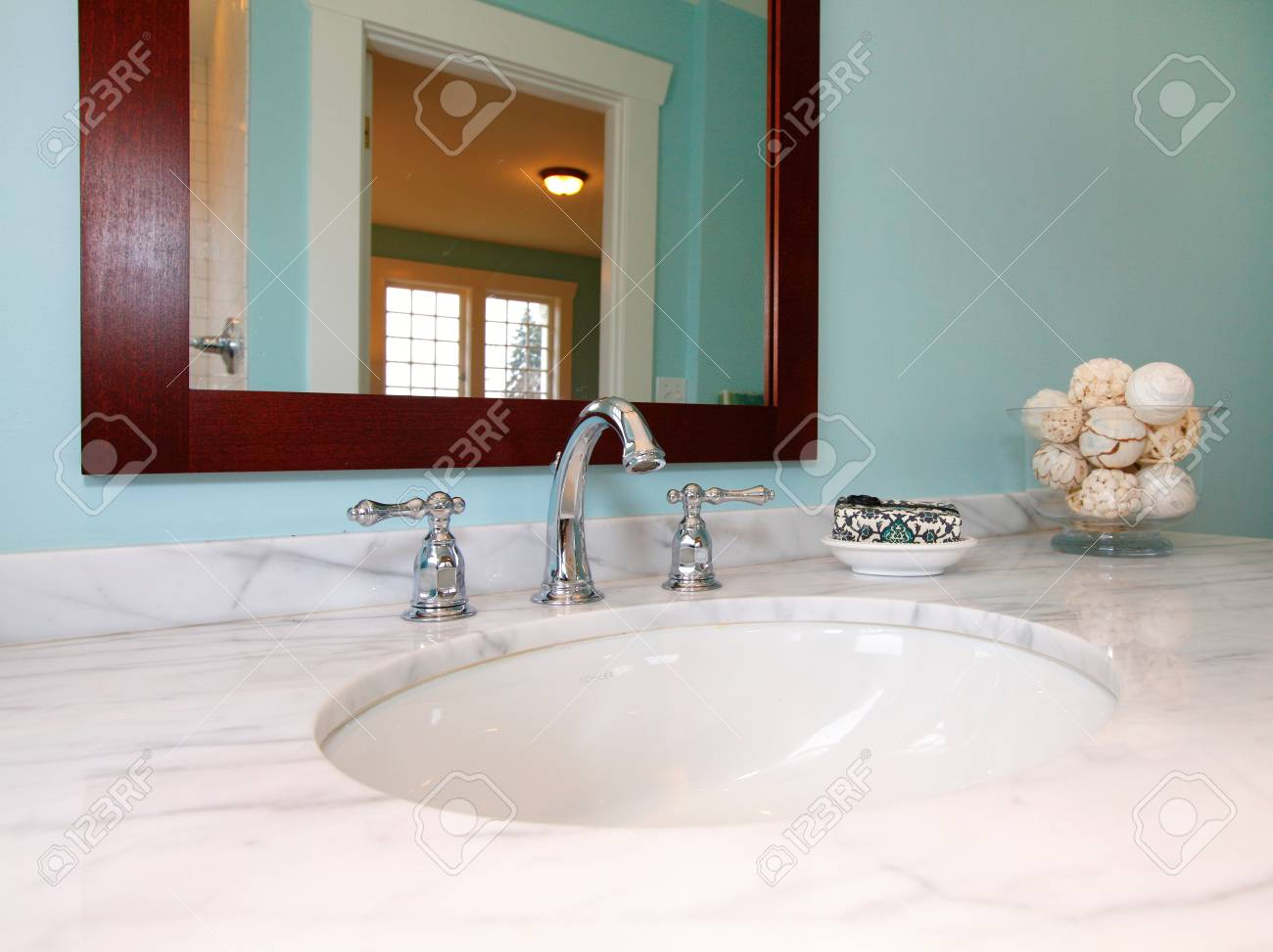 Blue Bathroom With White Marble Sink Stock Photo, Picture And ...