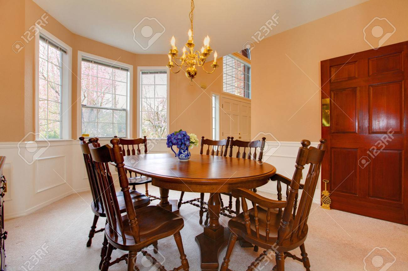 Soft Colors Dining Room With Carpet Floor Rustic Table Set And Cabinet Stock Photo