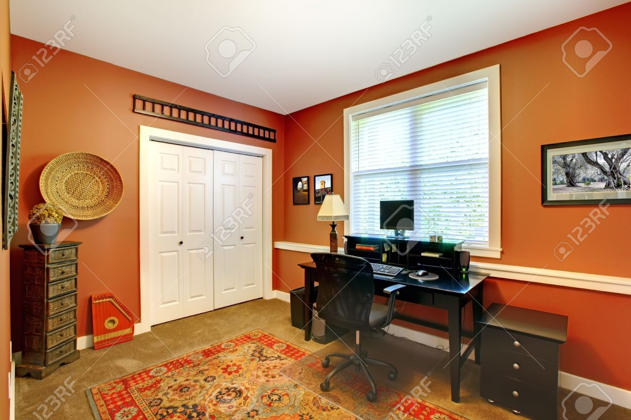Home Office Room With Bright Orange Walls And Carpet Floor Furnished ...