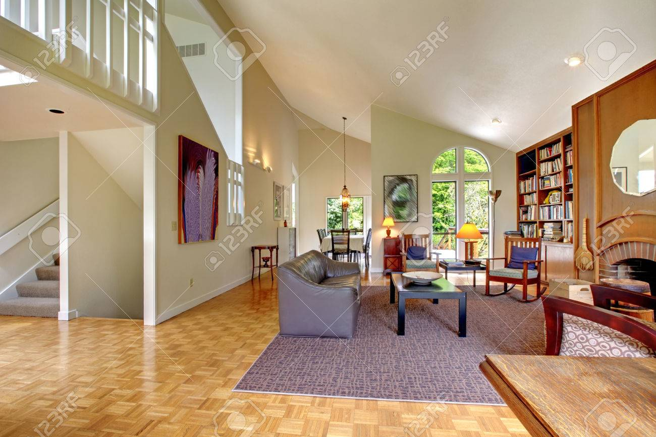 large room with high vaulted ceiling home library fireplace