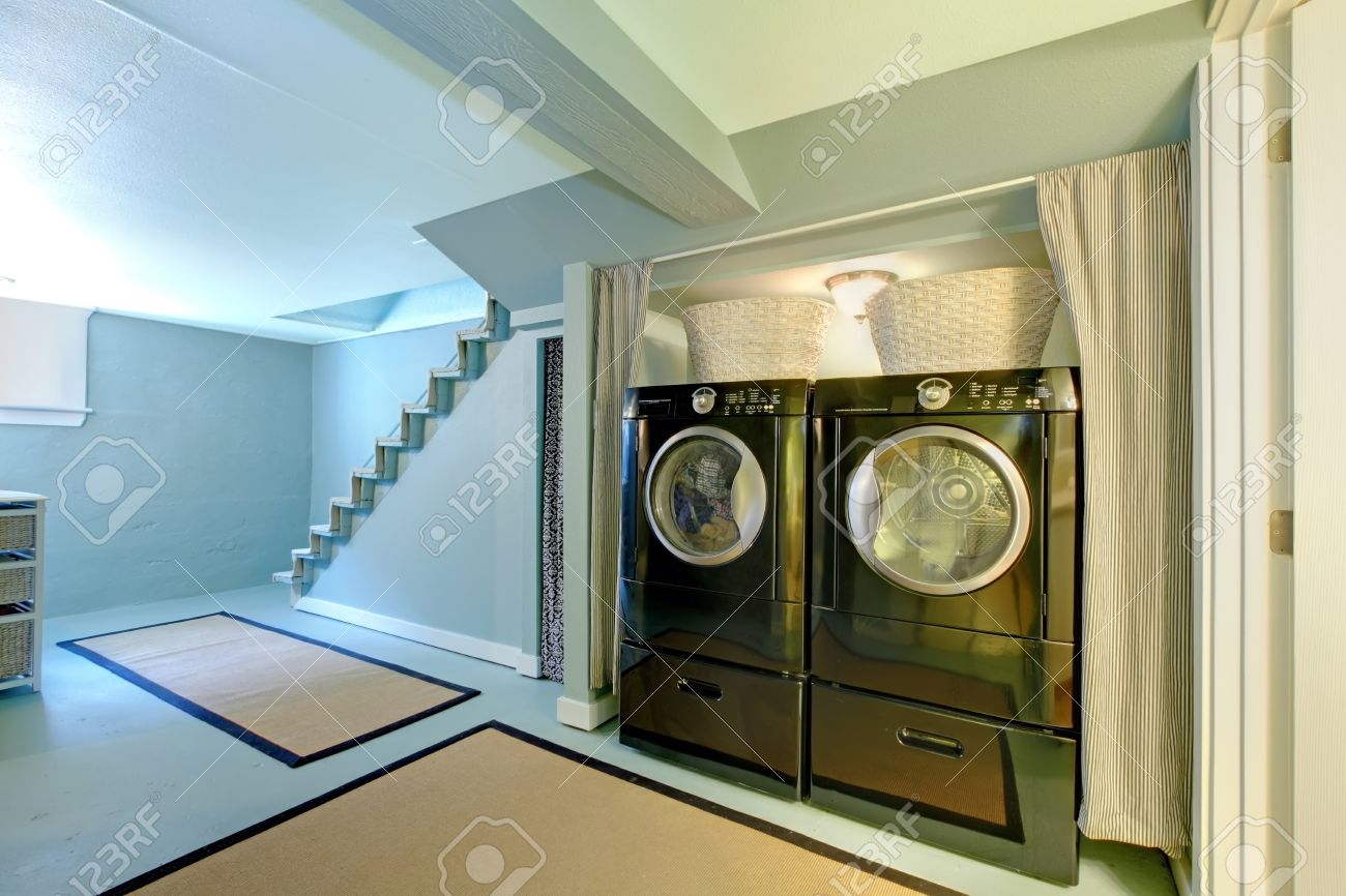 Blue Basement Laundry Room With Black Washe And Dryer. Stock Photo ...