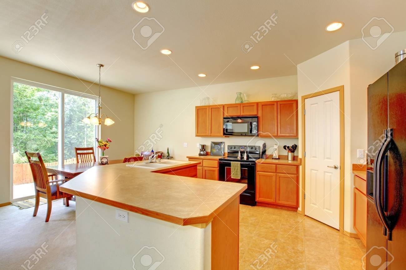 Kitchen room with dining area and walkout deck. View of cabinet with counter top Stock Photo - 29267149