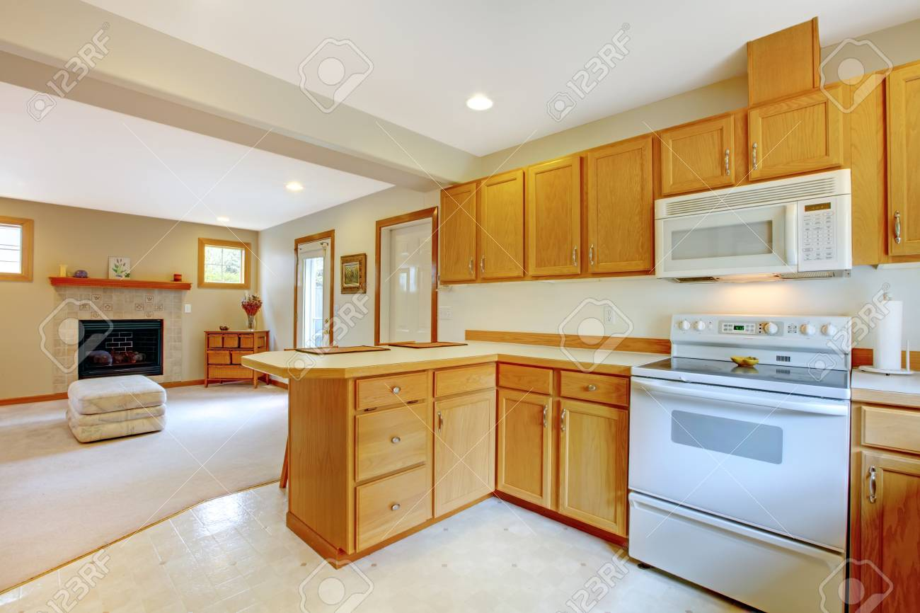 House interior. View of kitchen storage combination and living room with fireplace Stock Photo - 29001762