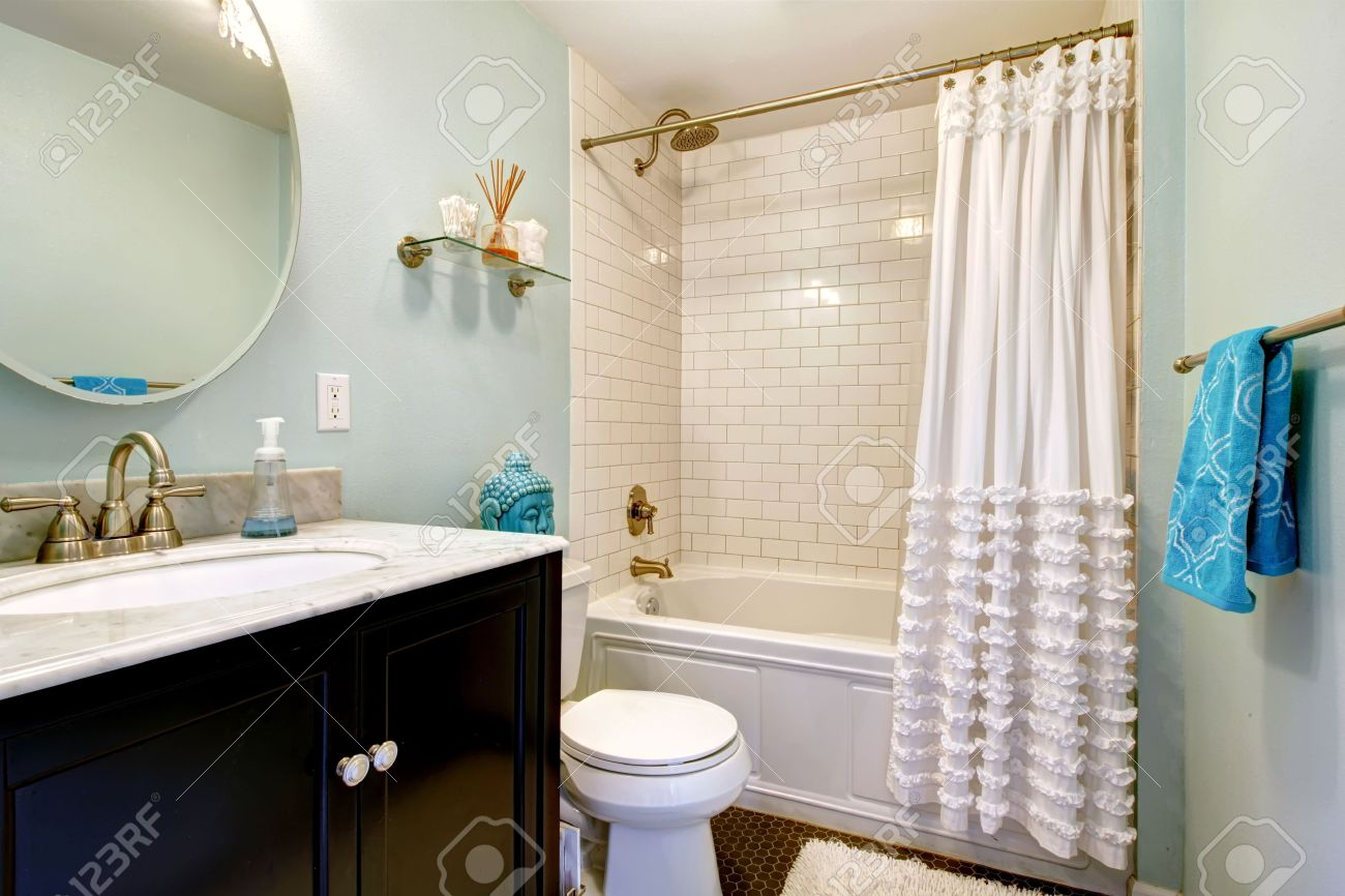 Aqua Bathroom With Dark Floor And Tile Wall Trim. View Of Bathroom ...