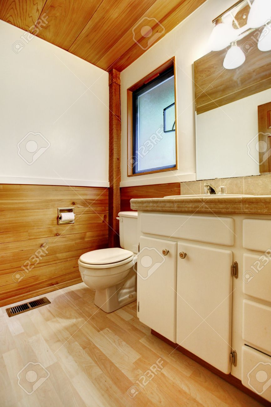 Stock Photo   White And Brown Cozy Bathroom With Old Bathroom Vanity Cabinet  In Log Cabin House