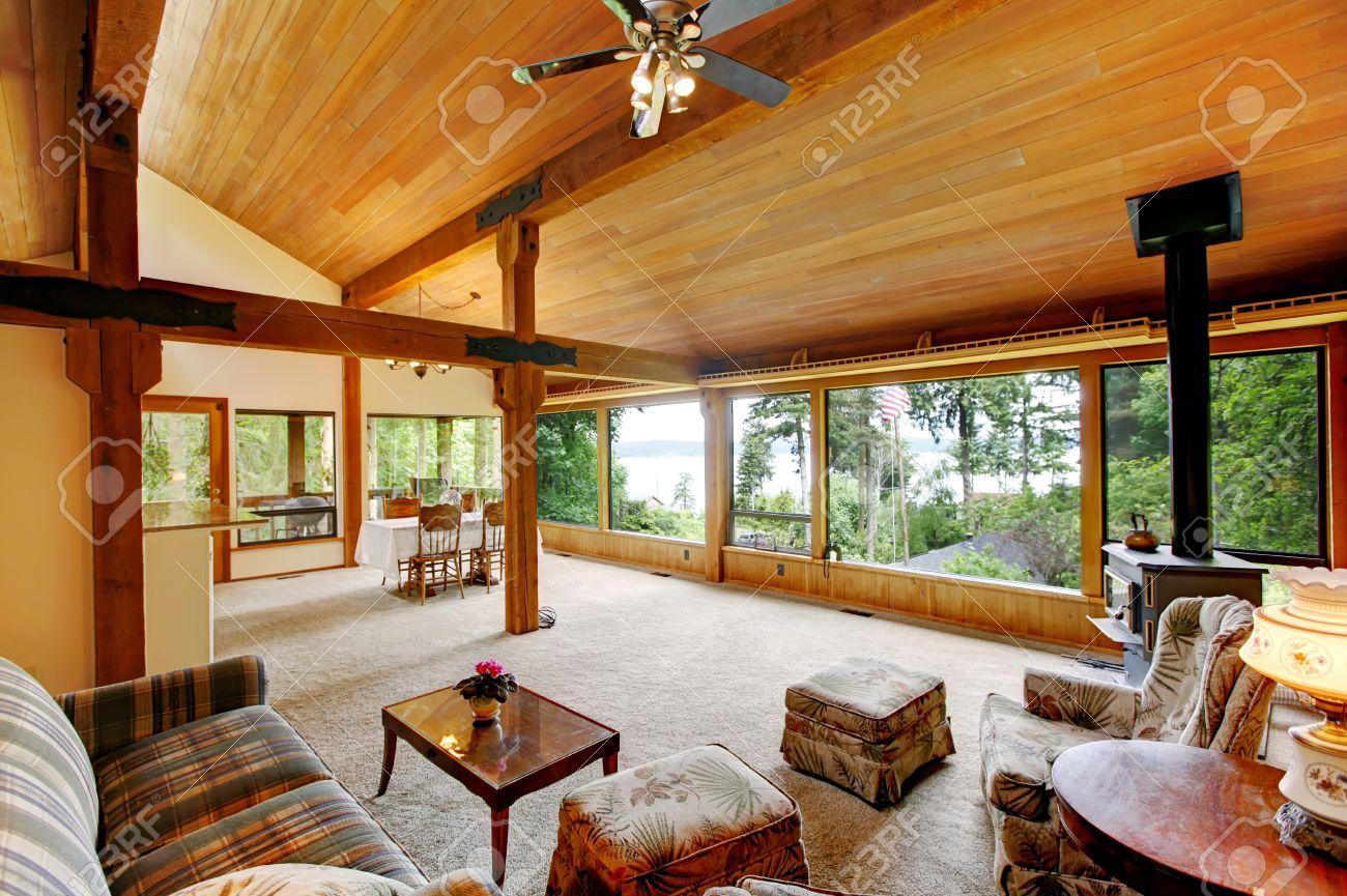 Open Floor Plan In Log Cabin House View Of Living Room And Dining Area Stock