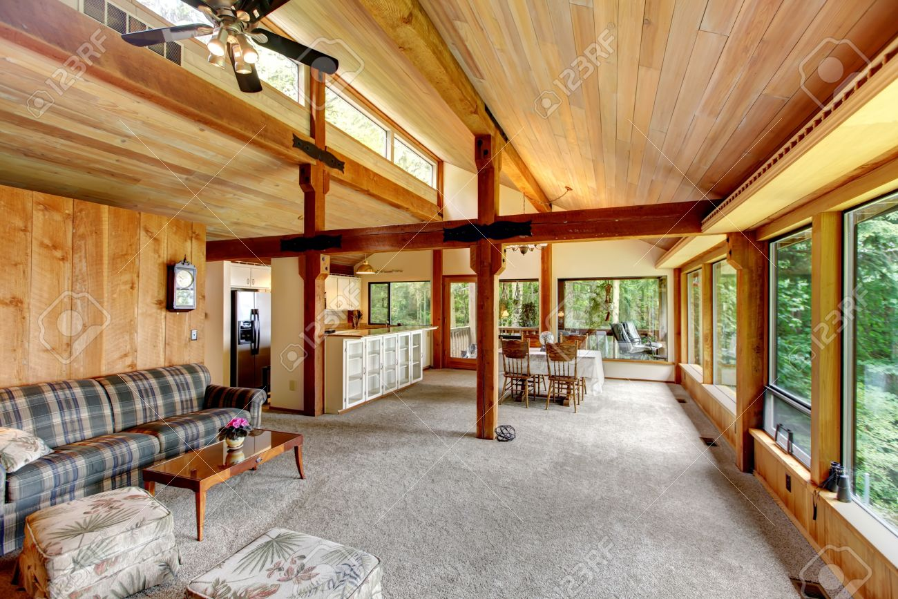 Open Floor Plan In Log Cabin House View Of Living Room And Kitchen With Dining